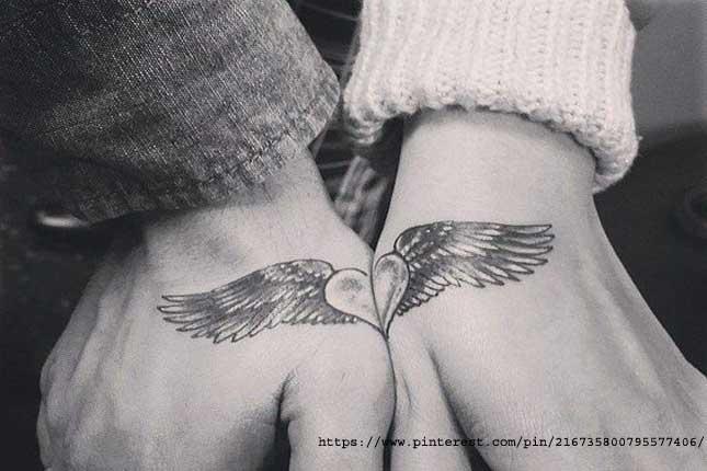 Matching hand tattoos