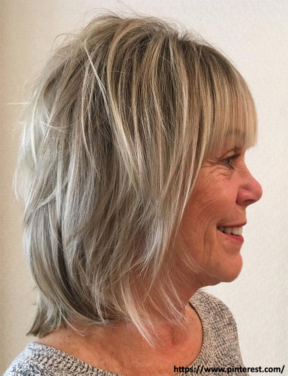 Feathered Midi Shag - hairstyles for women over 50